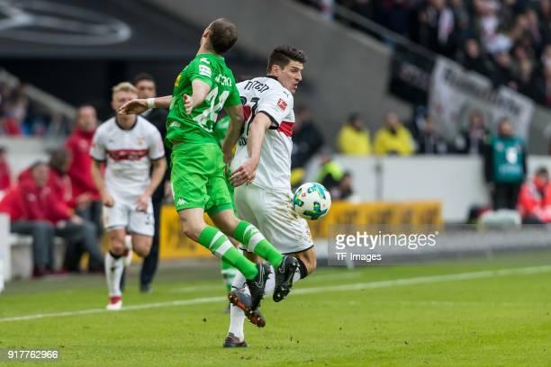 Tony Jantschke of Moenchengladbach and Mario Gomez Garcia of Stuttgart battle for the ball during the Bundesliga match between VfB Stuttgart and...