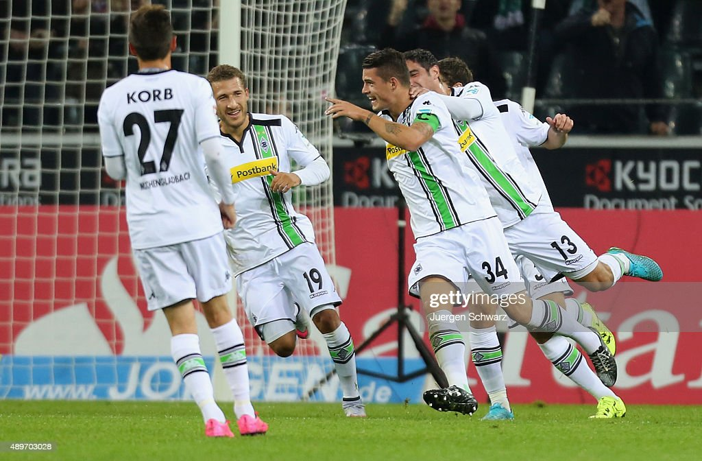 Tony Jantschke of Moenchengladbach (2ndR) celebrates with (L-R) Julian Korb, Fabian Johnson and Lars Stindl after scoring during the Bundesliga match between Borussia Moenchengladbach and FC Augsburg at Borussia-Park on September 23, 2015 in Moenchengladbach, Germany.