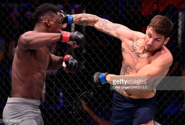 Tony Johnson punches Alton Cunningham in their light heavyweight bout during Dana White's Contender Series at the UFC Apex on June 25, 2019 in Las...