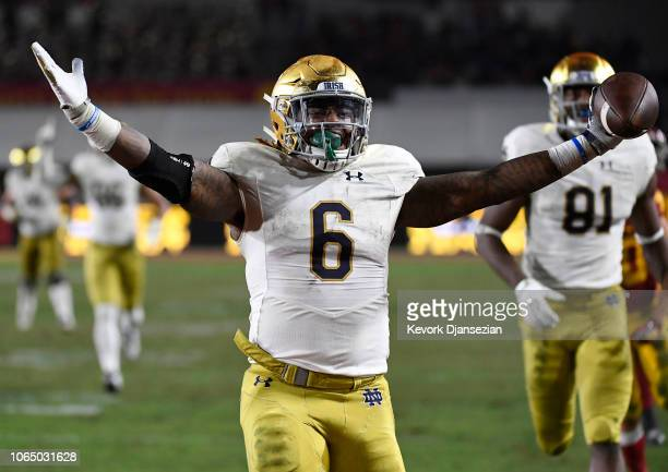 Tony Jones Jr. #6 of the Notre Dame Fighting Irish scores a touchdown against USC Trojans during the second half at Los Angeles Memorial Coliseum on...