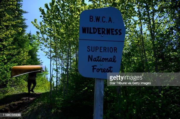 "Tony Jones portaged a canoe into the Boundary Waters Canoe Area on the famed ""Height of Land Portage"" from North Lake into South Lake Tuesday. Tony..."