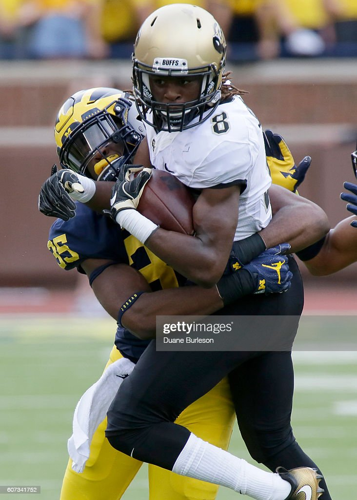 Tony Julmisse #8 of the Colorado Buffaloes is tackled by Joshua Uche #35 of the Michigan Wolverines at Michigan Stadium on September 17, 2016 in Ann Arbor, Michigan.