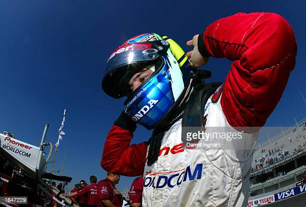 Tony Kanaan adjusts his HANS Device before climbing aboard the Mo Nunn Racing Honda Lola during the Gran Premio GiganteTelmex round 19 of the CART...