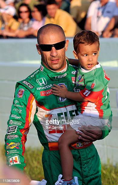 Tony Kanaan caries his son before the start of the Cafes do Brasil Indy 300 race at Homestead Miami Speedway in Homestead Florida Saturday October 2...
