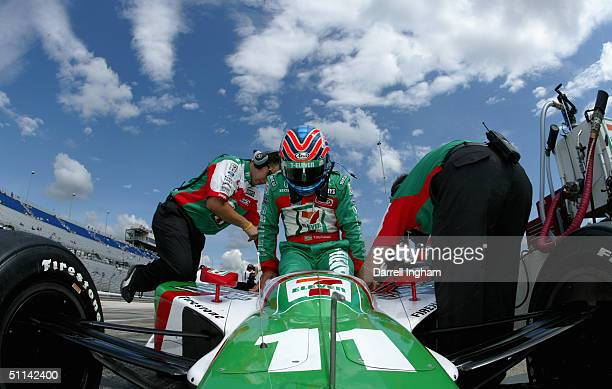 Tony Kanaan climbs aboard the Andretti Green Racing Team 7Eleven Honda Dallara during practice for the Indy Racing League IndyCar Series Menards...