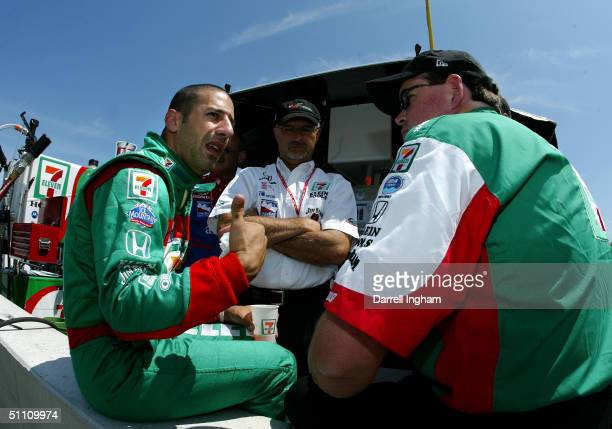 Tony Kanaan debriefs with his Andretti Green Racing engineers during practice for the Indy Racing League IndyCar Series Menards AJFoyt Indy 225 on...