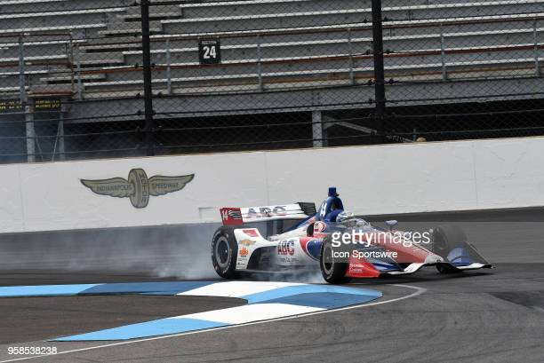 Tony Kanaan, driver of the A. J. Foyt Enterprises Chevrolet, locks up the brakes entering turn one during the warm-up session prior to the start of...