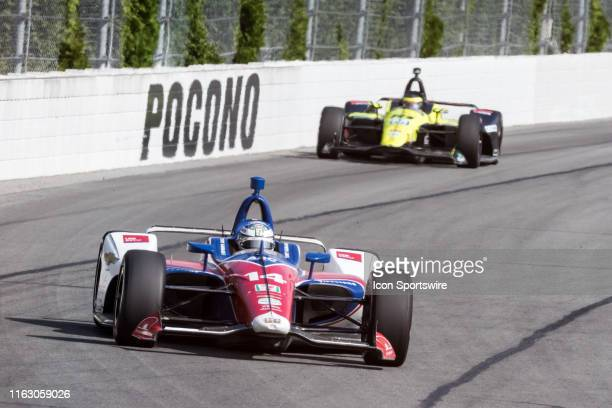 Tony Kanaan driver of the ABC Supply AJ Foyt Racing Chevrolet races into turn 2 during the ABC Supply 500 on August 18 at Pocono Raceway in Long Pond...