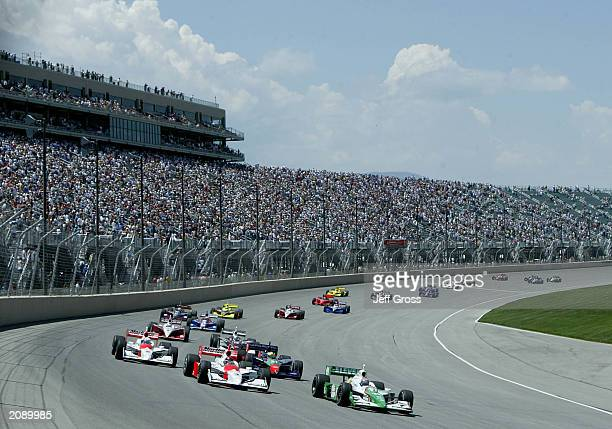Tony Kanaan driver of the Andretti Green Racing Team 7Eleven Honda Dallara leads the field into turn one during the start of the IRL IndyCar Series...