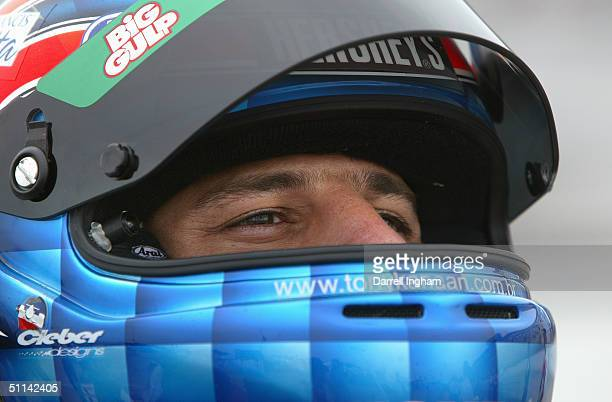 Tony Kanaan driver of the Andretti Green Racing Team 7Eleven Honda Dallara looks on during practice for the Indy Racing League IndyCar Series Menards...