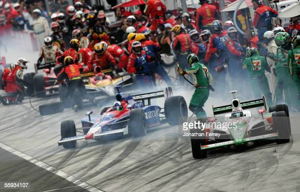 Tony Kanaan driver of the Andretti Green Racing Team Eleven Honda Dallara pulls out of the pits with teammate Dario Franchitti driver of the Andretti...