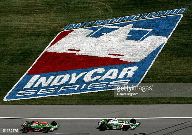 Tony Kanaan driving the Andreti Green Racing Team 7Eleven Honda Dallara leads eventual race winner Adrian Fernandez driving the Fernandez Racing...