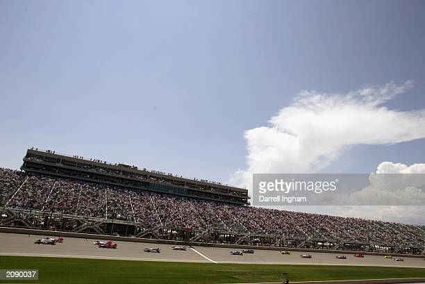 Tony Kanaan in the Andretti Green Racing Team 7Eleven Honda Dallara leads the pack at the start of the IRL IndyCar Series Honda Indy 225 at the Pikes...