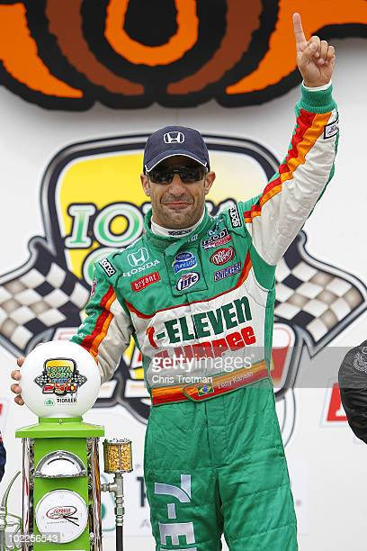 Tony Kanaan of Brazil driver of the 7Eleven Andretti Autosports Dallara Honda poses with the trophy after he won the IRL Indycar Series Iowa Corn...