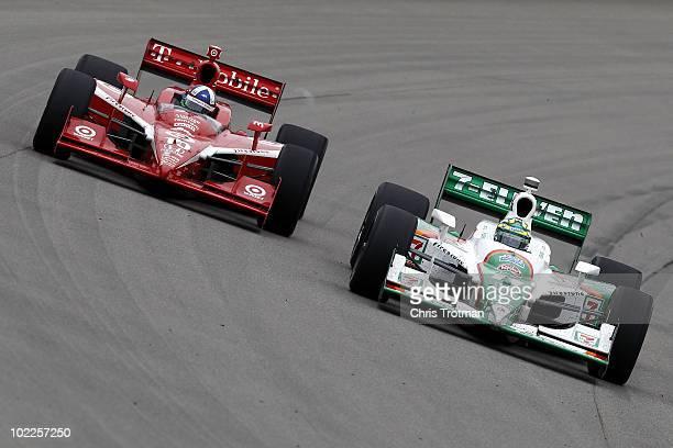 Tony Kanaan of Brazil driver of the 7Eleven Andretti Autosports Dallara Honda leads Dario Franchitti of Scotland driver of the Target Chip Ganassi...