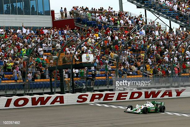 Tony Kanaan of Brazil driver of the 7Eleven Andretti Autosports Dallara Honda takes the checkered flag for victory at the IRL Indycar Series Iowa...