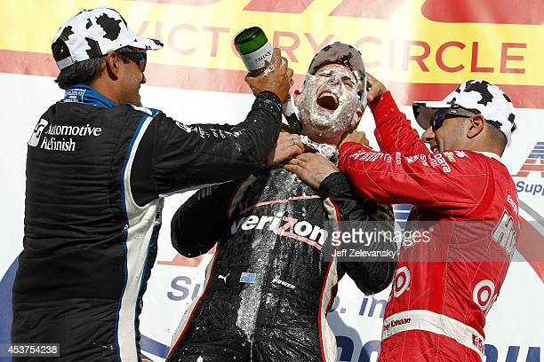Tony Kanaan of Brazil driver of the Huggies Target Chip Ganassi Racing Chevrolet and Juan Pablo Montoya of Colombia driver of the PPG Team Penske...