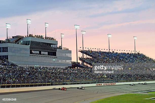 Tony Kanaan of Brazil driver of the Target Chip Ganassi Racing Dallara Chevrolet leads a pack of cars during the Iowa Corn Indy 300 at Iowa Speedway...