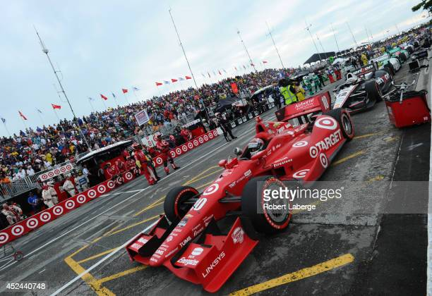 Tony Kanaan of Brazil driver of the Target Chip Ganassi Racing Dallara Chevrolet waits in pit lane during a red flag during race 2 of the Verizon...