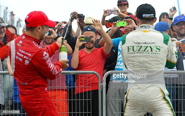 Tony Kanaan of Brazil driver of the Target Chip Ganassi Racing Dallara Chevrolet, second place finisher and Mike Conway of England driver of the Ed...