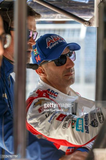 Tony Kanaan studies the timing numbers in his pit box during the IndyCar Spring Training on February 12 at Circuit of the Americas in Austin TX