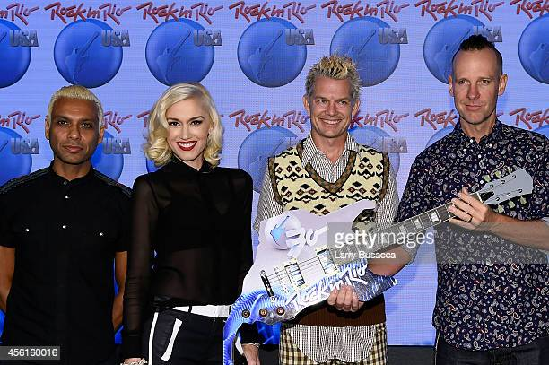 Tony Kanal, Gwen Stefani, Tom Dumont and Adrian Young of No Doubt pose onstage during the Rock In Rio USA event in Times Square on September 26, 2014...