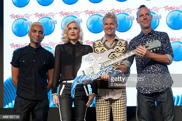 Tony Kanal, Gwen Stefani, Tom Dumont, and Adrian Young of No Doubt pose on stage during the Rock In Rio USA event in Times Square on September 26,...