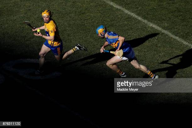Tony Kelly of Clare breaks away from Ger Brown of Tipperary during their match in the 2017 AIG Fenway Hurling Classic and Irish Festival at Fenway...