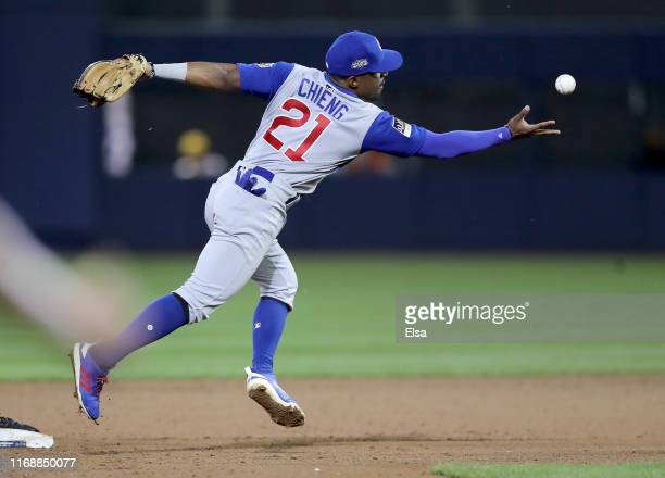 Tony Kemp of the Chicago Cubs chases after a bobbled ball after Starling Marte of the Pittsburgh Pirates stole second in the sixth inning during the...