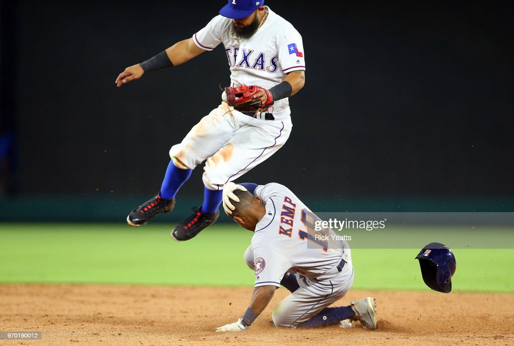 Tony Kemp #18 of the Houston Astros beats the tag against Rougned Odor #12 of the Texas Rangers in the ninth inning at Globe Life Park in Arlington on June 8, 2018 in Arlington, Texas.