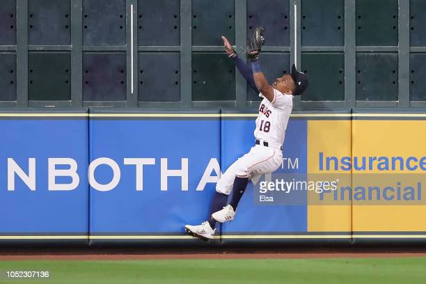 Tony Kemp of the Houston Astros catches a deep fly ball against the left field wall in the third inning against the Boston Red Sox during Game Three...