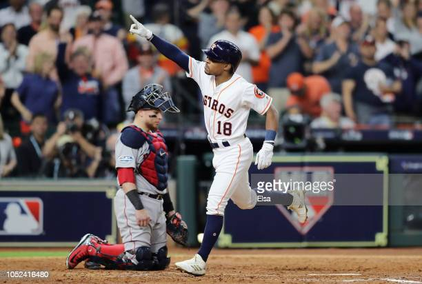 Tony Kemp of the Houston Astros celebrates after hitting a solo home run in the fourth inning against the Boston Red Sox during Game Four of the...