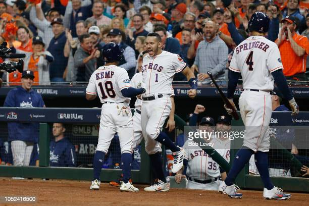 Tony Kemp of the Houston Astros celebrates with Carlos Correa after hitting a solo home run in the fourth inning against the Boston Red Sox during...