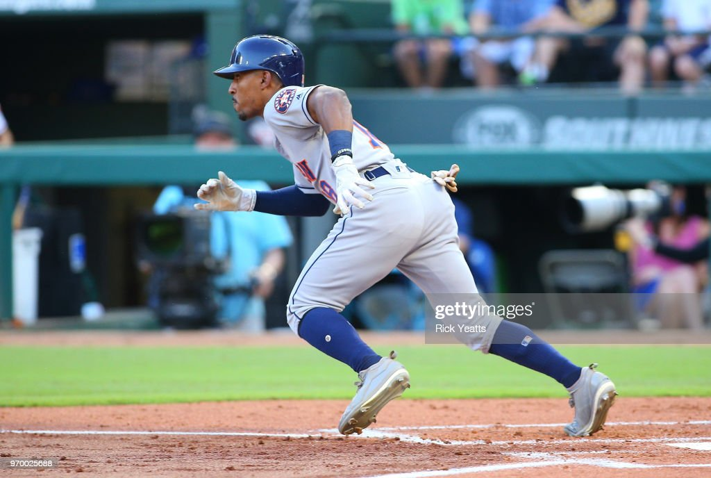 Tony Kemp #18 of the Houston Astros hits a single RBI in the second inning against the Texas Rangers at Globe Life Park in Arlington on June 8, 2018 in Arlington, Texas.