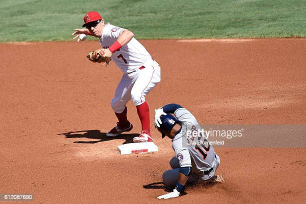 Tony Kemp of the Houston Astros is out at first base in the first inning against Cliff Pennington of the Los Angeles Angels of Anaheim at Angel...