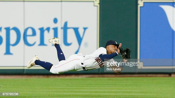 Tony Kemp of the Houston Astros make a diving catch on a line drive by Willy Adames of the Tampa Bay Rays in the first inning at Minute Maid Park on...