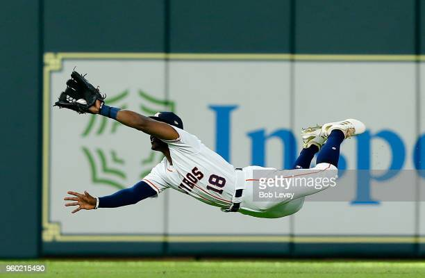 Tony Kemp of the Houston Astros makes a diving catch on a line drive by Brandon Guyer of the Cleveland Indians in the third inning at Minute Maid...