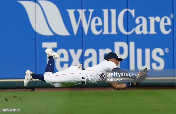 Tony Kemp of the Houston Astros makes a diving catch on line drive by Logan Forsythe of the Minnesota Twins in the first inning at Minute Maid Park...