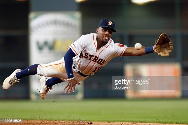 Tony Kemp of the Houston Astros makes a diving stop on a sharp hit ball by Charlie Tilson of the Chicago White Sox in the fifth inning at Minute Maid...