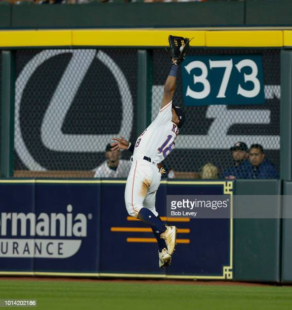 Tony Kemp of the Houston Astros makes a leaping catch on a line drive by Jean Segura of the Seattle Mariners in the sixth inning at Minute Maid Park...