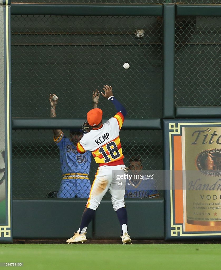 Tony Kemp #18 of the Houston Astros plays the ball off the wall on a Nelson Cruz #23 of the Seattle Mariners double in ghe eighth inning at Minute Maid Park on August 10, 2018 in Houston, Texas.