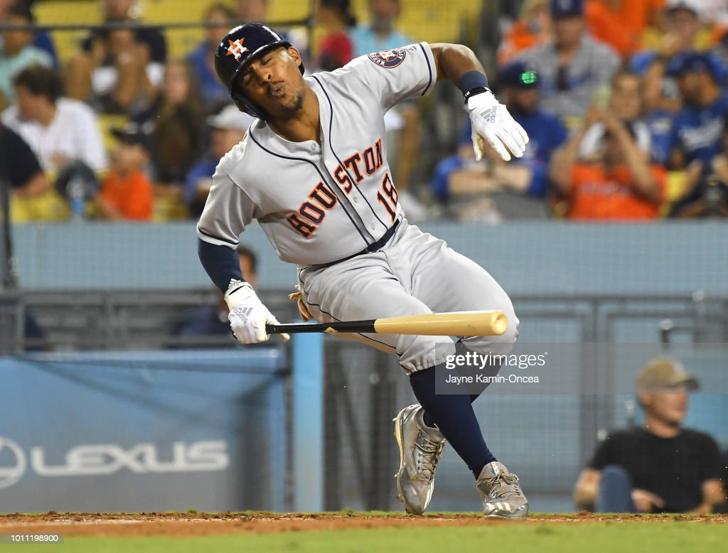 Tony Kemp #18 of the Houston Astros reacts after he was hit in the foot by a ball in the eighth inning against the Los Angeles Dodgers at Dodger Stadium on August 4, 2018 in Los Angeles, California. Kemp left the game.