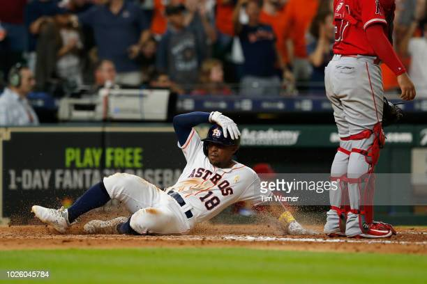 Tony Kemp of the Houston Astros scores in the eighth inning against the Los Angeles Angels of Anaheim at Minute Maid Park on September 1 2018 in...