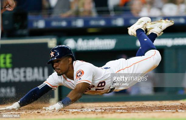 Tony Kemp of the Houston Astros scores in the seventh inning against the Boston Red Sox at Minute Maid Park on June 3 2018 in Houston Texas