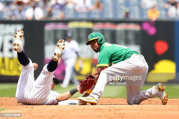 Tony Kemp of the Oakland Athletics steals second base as second baseman Rougned Odor of the New York Yankees rolls over to make a late tag during the...