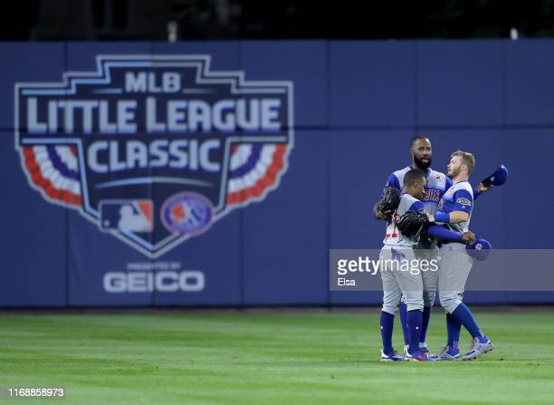 Tony KempJason Heyward and Ian Happ of the Chicago Cubs celebrate the 71 win over the Pittsburgh Pirates during the MLB Little League Classic at...