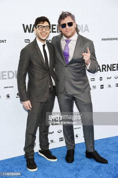 Tony Khan and Kenny Omega of TNT's All Elite Wrestling attends the WarnerMedia Upfront 2019 arrivals on the red carpet at The Theater at Madison...