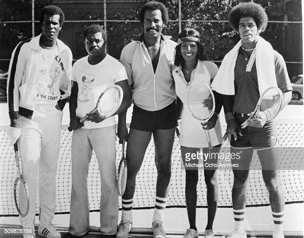 Tony King D'Urville Martin Fred Williamson Pam Grier and Jim Kelly pose for a portrait playing tennis on the streets of Harlem 1975 in in New York
