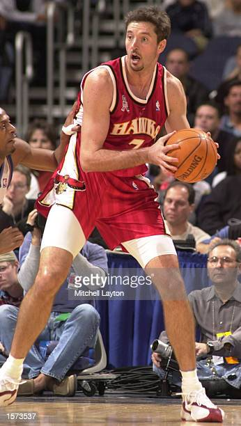 Tony Kukoc of the Atlanta Hawks works the ball around the floor during a game against the Washington Wizards at the MCI Center in Washington DC...