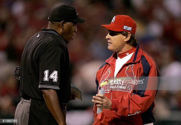 Tony La Russa Manager of the St Louis Cardinals has a discussion with home plate umpire Chuck Meriwether during game four of the 2004 World Series...